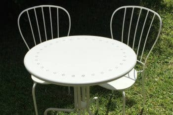 Round signing table and two garden chairs